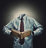 Invisible man. In a business suit reading a book Royalty Free Stock Image