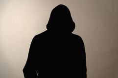 Invisible man in the hood. grey background Stock Image
