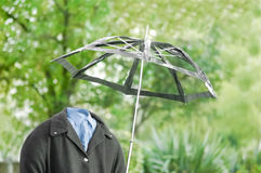 Invisible man. Out for a walk in the rain Stock Photos