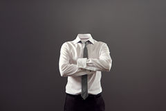 Invisible man standing with folded arms stock photo