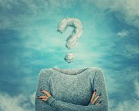 Invisible woman. Surreal image as woman with crossed hands and invisible face has a question mark shaped cloud instead of head. Social mask for hiding his Stock Photo