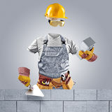 Invisible worker with trowel and brick wall Royalty Free Stock Image