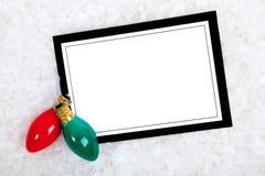 Invitación con las luces de la Navidad Fotos de archivo