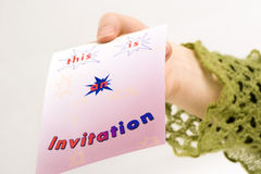 Invitation 1. Someone's hand giving an invitation.  stars decorate the card Stock Image