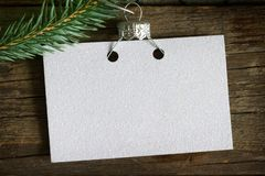 Invitation business empty card on the Christmas tree abstract background concept royalty free stock image