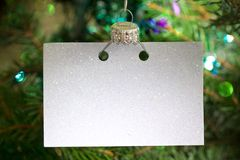 Invitation business empty card on the Christmas tree abstract background concept stock images