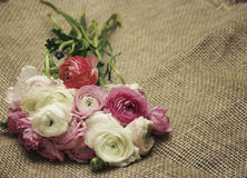 Invitation card. Bouquet of flowers on burlap in retro style Stock Photography