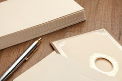 Invitation card and envelop. Invitation card and stack of letter on wood table stock photo