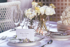 Invitation card on outdoor wedding table Royalty Free Stock Photo