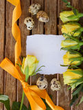 Invitation card with yellow roses and eggs Royalty Free Stock Photo