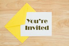 You`re invited message on wood table stock photography