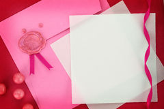 Invitation or greeting card on pink envelope. Paper card and pink envelope with sealing wax stamp royalty free stock images