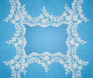 Invitation, greeting or wedding card. Invitation, greeting or wedding card with white lace on blue background Royalty Free Stock Photo