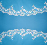 Invitation, greeting or wedding card. Invitation, greeting or wedding card with white lace on blue background Stock Photos