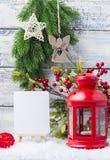 invitation new year Красные подсвечник и рождественская елка sprig Тема Нового Года и рождества стоковая фотография