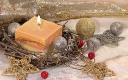 invitation new year 圣诞节在装饰银和金球的大在金背景的蜡烛和星 新年` s设计 免版税库存图片