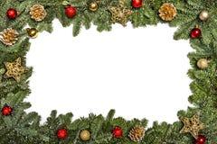 invitation new year 圣诞节装饰常青树开花问候一品红红色结构树 与新年的装饰,圣诞树分支、金黄锥体、金黄星和红色的框架 库存照片