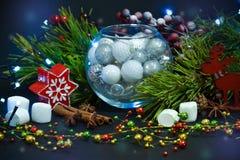invitation new year 在玻璃球形的圣诞装饰 祝贺假日 免版税图库摄影