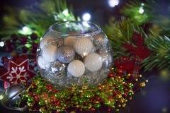 invitation new year 在玻璃球形的圣诞装饰 祝贺假日 免版税库存图片