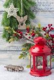 invitation new year 红色烛台和小树枝圣诞树 新年和圣诞节的题材 免版税图库摄影