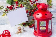 invitation new year 红色烛台和小树枝圣诞树 新年和圣诞节的题材 图库摄影