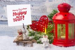 invitation new year 红色烛台和小树枝圣诞树 新年和圣诞节的题材 免版税库存图片