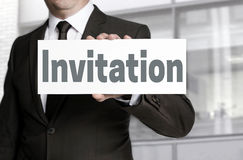 Invitation sign is held by businessman Stock Photo