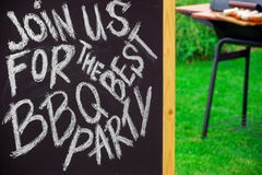 An Invitation To A Barbecue Party, Written on Blackboard Stock Photography