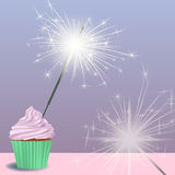 Invitation to the birthday party with a cupcake, sparklers Royalty Free Stock Photos