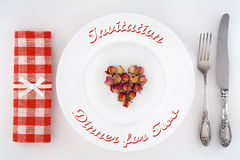 Invitation to dinner for two. Table setting with heart of roses. royalty free stock photography