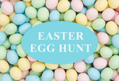 Invitation to an Easter Egg Hunt. Retro Easter eggs candy with text Easter Egg Hunt stock photos
