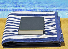 Invitation to read on holiday by the water Stock Images