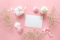 Invitation to a wedding or a greeting with the marriage, christenings in white pink colors with a space for text, flat lay. Horizontal. Top view Stock Photo