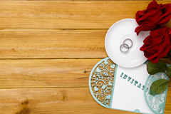 Invitation to the wedding with wedding rings Royalty Free Stock Photo