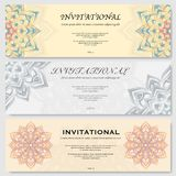 Invitational cards set. Set of three colorful invitational posters with abstract mandala silhouettes Stock Photos