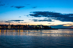 The inviting beach. Sunset on the Volga River. In the distance can be seen the shore of the city of Cheboksary, Russia Royalty Free Stock Photo