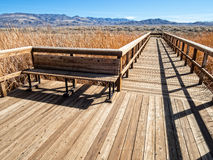 Inviting bench and boardwalk. Boardwalk and bench, Stillwater National Wildlife Refuge Royalty Free Stock Image