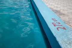 Inviting blue pool with 2.70m depth marking royalty free stock photography