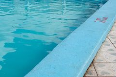 Inviting blue pool with 2.70m depth marking stock images