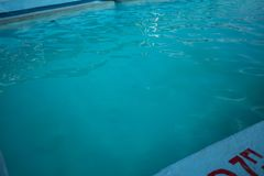 Inviting blue pool with ripples on the surface royalty free stock images