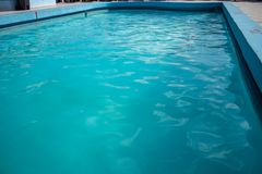 Inviting blue pool with ripples on the surface royalty free stock photo