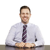 Inviting business man sitting at table Royalty Free Stock Photos