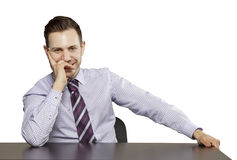 Inviting business man sitting at table Royalty Free Stock Image