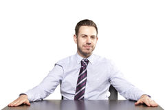 Inviting business man sitting at table Royalty Free Stock Images