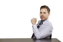 Inviting business man sitting at table Stock Images