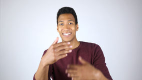 Inviting Customers, Welcoming Young Afro-American Man. High quality Royalty Free Stock Image