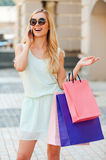 Inviting friend for shopping. Stock Photography