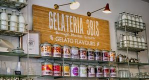Inviting Gelato Shop Display with Retro Milk Bottles stock photo