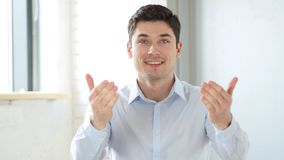 Inviting Man in Office with Hands, Indoor Stock Photo