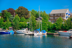 Inviting marine view with yacht and boats sitting in the lake Royalty Free Stock Images